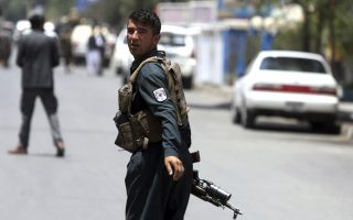 A security personnel looks back as he arrives at the site of a would-be suicide attack near a park, in Kabul, Afghanistan, Monday, July 16, 2018. A would-be suicide attacker was shot and killed by police in Kabul before he was able to get close to a gathering of supporters of the country's first vice president, Gen. Abdul Rashid Dostum, according to police spokesman Hashmat Stanekzai. Dostum is currently in Turkey. (AP Photo/Rahmat Gul)