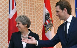Austrian Chancellor Sebastian Kurz, right, greets Britain's Prime Minister Theresa May prior a meeting in the hotel Sacher in Salzburg, Austria, on Friday, July 27, 2018. (AP Photo/Kerstin Joensson)