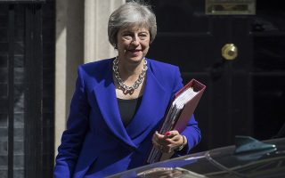 Britain's Prime Minister Theresa May leaves 10 Downing Street in London, bound for the House of Commons to the scheduled Prime Minister's Questions, Wednesday July 18, 2018. May is to visit the border area between Northern Ireland and Ireland during a two-day tour, Downing Street announced Wednesday. (Dominic Lipinski/PA via AP)