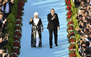 Turkey's President Recep Tayyip Erdogan, accompanied by his wife Emine, arrives for a ceremony at the Presidential Palace in Ankara, Turkey, Monday, July 9, 2018. Turkish President Recep Tayyip Erdogan was sworn in Monday under a new governing system that grants him sweeping executive powers, which critics say give him far too much control. (AP Photo)