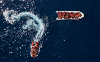 Refugees and migrants are rescued by members of the Spanish NGO Proactiva Open Arms, after leaving Libya trying to reach European soil aboard an overcrowded rubber boat, north of the Libyan coast, on Sunday, May 6, 2018. In total, 105 refugees and migrants from various countries, including Bangladesh, Egypt, Nigeria, Marrocos, Gana, Pakistan, Sudan, Libya, Eritrea and Senegal, were rescued from the overcrowded rubber boat. (AP Photo/Felipe Dana)