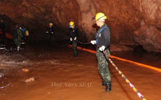 epa06866883 A handout photo made available by the Thai Navy SEAL on 06 July 2018 shows Thai military personnel carrying equipment inside a cave complex during the ongoing rescue operations for the youth soccer team and their assistant coach, at Tham Luang cave in Khun Nam Nang Non Forest Park, Chiang Rai province, Thailand. According to latest reports, a former Thai Navy diver has died during the rescue operations to safely bring out the youth soccer team out of the cave. Rescuers are bringing supplies and food into the cave, where the missing 12 boys and their coach remain trapped since 23 June, as efforts to drain the cave have not been successful due to rainy weather.  EPA/THAI NAVY SEAL HANDOUT  HANDOUT EDITORIAL USE ONLY/NO SALES