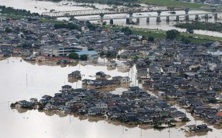 epa06873438 Takahashi River is flooded in Kurashiki, Okayama Prefecture, western Japan,  08 July 2018. Heavy rainfall killed 73 people and missing 63 people at least in southwestern and western Japan, public television reported on 08 July 2018. Japan Meteorological Agency has warned record rainfall on 06 July for flooding, mudslides in southwestern and western Japan through 08 July and issued emergency weather warnings to six prefectures. In nine prefectures in western and southwestern Japan,  authorities issued evacuation orders to more than for million of people in southwestern and western Japan.  EPA/JIJI PRESS JAPAAN OUT  EDITORIAL USE ONLY/NO SALES/NO ARCHIVES