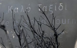 A burned sign is seen in Mati, east of Athens, Wednesday, July 25, 2018. Rescue crews were searching Wednesday through charred homes and cars for those still missing after the deadliest wildfires to hit Greece in decades decimated seaside areas near Athens, killing at least 79 people and sending thousands fleeing. (AP Photo/Thanassis Stavrakis)