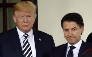 President Donald Trump, left, and Italian Prime Minister Giuseppe Conte, right, pose for a photo as Conte arrives at the West Wing in Washington, Monday, July 30, 2018. (AP Photo/Susan Walsh)