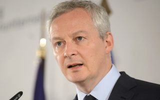 French Finance Minister Bruno Le Maire speaks at the  meeting of the Foundation for Family Businesses in Germany and Europe in Berlin, Friday, June 8, 2018. (Sina Schuldt/dpa via AP)