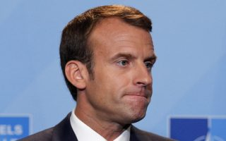 French President Emmanuel Macron speaks at a press conference after a summit of heads of state and government at NATO headquarters in Brussels, Belgium, Thursday, July 12, 2018. (AP Photo/Francois Mori)