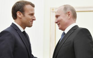 Russian President Vladimir Putin, right, shakes hands with French President Emmanuel Macron during their meeting in the Kremlin in Moscow, Russia, Sunday, July 15, 2018. (Yuri Kadobnov/Pool Photo via AP)