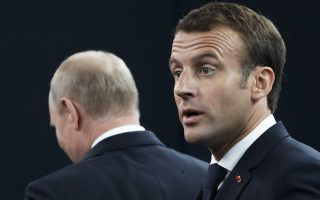 French President Emmanuel Macron, right, and Russian President Vladimir Putin leave a panel discussion during the St. Petersburg International Economic Forum in St. Petersburg, Russia, Friday, May 25, 2018. (AP Photo/Dmitri Lovetsky, Pool)
