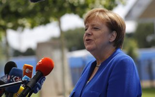 German Chancellor Angela Merkel speaks as she arrives for a summit of heads of state and government at NATO headquarters in Brussels on Wednesday, July 11, 2018. NATO leaders gather in Brussels for a two-day summit to discuss Russia, Iraq and their mission in Afghanistan. (AP Photo/Francois Mori)