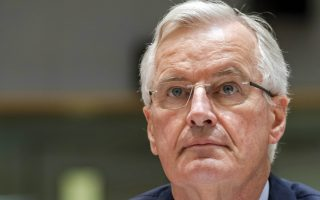 EU's chief Brexit negotiator Michel Barnier, center, attends a General Affairs Council meeting to discuss article 50 at the Europa building in Brussels, Friday, July 20, 2018. (AP Photo/Geert Vanden Wijngaert)
