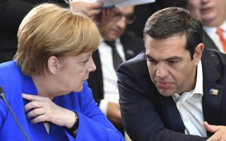 German Chancellor Angela Merkel, left, and Greek Prime Minister Alexis Tsipras talk prior to a meeting of the North Atlantic Council during a summit of heads of state and government at NATO headquarters in Brussels on Wednesday, July 11, 2018. NATO leaders gather in Brussels for a two-day summit to discuss Russia, Iraq and their mission in Afghanistan. (AP Photo/Geert Vanden Wijngaert)