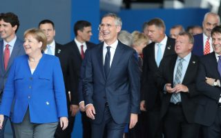 Germany's Chancellor Angela Merkel, Canadian Prime Minister Justin Trudeau, NATO Secretary-General Jens Stoltenberg and Italian Prime Minister Giuseppe Conte are seen at NATO headquarters in Brussels, Belgium, July 11, 2018. Tatyana Zenkovich/Pool via REUTERS