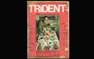 Εξώφυλλο του περιοδικού της British European Airways του 1972 απεικονίζει στρωμένο τραπέζι στον Βασίλαινα: στο κέντρο τα καλοτηγανισμένα μπαρμπούνια του.