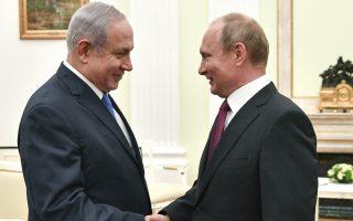 Russian President Vladimir Putin, right, shakes hands with Israeli Prime Minister Benjamin Netanyahu during their meeting at the Kremlin in Moscow, Wednesday, July 11, 2018. (Yuri Kadobnov/ Pool photo via AP)