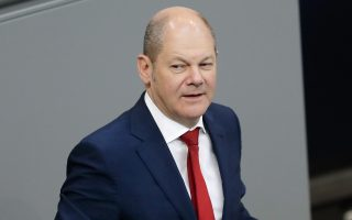 German Finance Minister Olaf Scholz delivers a speech during a budget debate at the German parliament, Bundestag, at the Reichstag building in Berlin, Germany, Tuesday, July 3, 2018. (AP Photo/Markus Schreiber)