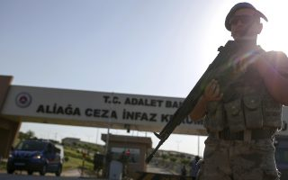 Members of Turkish forces guard the entrance of a prison complex in Aliaga, Izmir province, western Turkey, where jailed US pastor Andrew Craig Brunson is appearing on trial at a court inside the complex, Wednesday, July 18, 2018. The 50-year-old evangelical pastor from Black Mountain, North Carolina, faces up 35 years in prison in Turkey on charges of