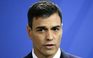 The Prime Minister of Spain Pedro Sanchez attends a news conference with German Chancellor Angela Merkel after talks at the chancellery in Berlin, Tuesday, June 26, 2018. (AP Photo/Markus Schreiber)