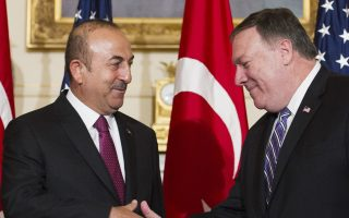Secretary of State Mike Pompeo, right, meets with Turkish Foreign Minister Mevlut Cavusoglu at the State Department in Washington, Monday, June 4, 2018. (AP Photo/Cliff Owen)
