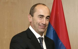 Armenian President Robert Kocharyan (L) is welcomed by the European Union Chief Javier Solana (R) prior to a bilateral meeting in the European Council, 20 October 2005, in Brussels. AFP PHOTO EUROPEAN COUNCIL