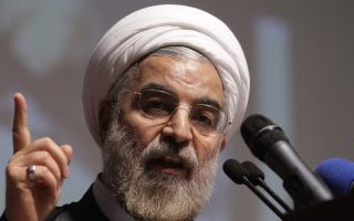 Iran's former nuclear negotiator, Hasan Rohani, a potential front-runner in the presidential race, addresses, in a campaign rally in Tehran, Iran, Thursday, May 2, 2013. One candidate stresses Iran's need to find ways to persuade the world that it can possess nuclear technology without building a bomb. Another thinks Iran's international reputation has taken unwelcome hits from the diatribes of President Mahmoud Ahmadinejad. More than a few say there's no reason Washington must remain a permanent enemy. While the race to succeed Ahmadinejad still hasn't reached the official starting gate _ formal registration for candidates begins next week _ comments from presumed front-runners for the June 14 ballot offer an overview that suggests less bombast and more measured diplomacy from Iran's highest elected leader. (AP Photo/Vahid Salemi)