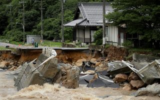epa06870103 A road is destroyed due to heavy train in Higashihiroshima, Hiroshima Prefecture, Japan, 07 July 2018. Heavy rainfall killed at least 15 people and left more than 45 missing, public television reported on 07 July 2018. Japan Meteorological Agency has warned record rainfall on 06 July for flooding, mudslides in southwestern and western Japan through 08 July and issued emergency weather warnings to six prefectures. In nine prefectures in western and southwestern Japan, authorities issued evacuation orders to more than one million people as Typhoon Maria passes the area.  EPA/JIJI PRESS JAPAN OUT EDITORIAL USE ONLY  NO ARCHIVES