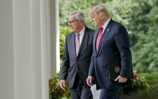 President Donald Trump, right, and European Commission president Jean-Claude Juncker, walk out to speak in the Rose Garden of the White House, Wednesday, July 25, 2018, in Washington. (AP Photo/Pablo Martinez Monsivais)
