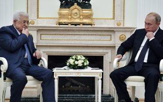 Russian President Vladimir Putin, right, and Palestinian President Mahmoud Abbas sit during their meeting in the Kremlin in Moscow, Russia, Saturday, July 14, 2018. (Yuri Kadobnov/Pool Photo via AP)