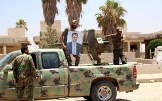 Στρατιώτες του Ασαντ στην καταληφθείσα πόλη Ντεράα. Από εκεί άρχισαν οι διαδηλώσεις κατά του καθεστώτος το 2011.