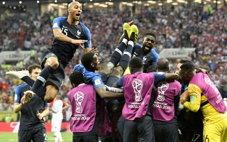 French players celebrate after Kylian Mbappe scored his side's fourth goal during the final match between France and Croatia at the 2018 soccer World Cup in the Luzhniki Stadium in Moscow, Russia, Sunday, July 15, 2018. (AP Photo/Martin Meissner)