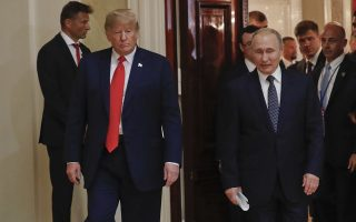U.S. President Donald Trump, left, and Russian President Vladimir Putin, right, walk in together to begin their joint news conference at the Presidential Palace in Helsinki, Finland, Monday, July 16, 2018. (AP Photo/Pablo Martinez Monsivais)