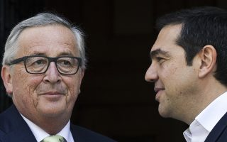 European Commission President Jean-Claude Juncker, left, waves as he is greeted by Greek Prime Minister Alexis Tsipras prior to their meeting in Athens, Thursday, April 26, 2018. Juncker will discuss Greece's fiscal reform plans after its international bailout program ends in a few months' time. (AP Photo/Petros Giannakouris)