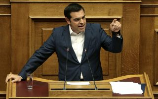 Ο πρωθυπουργός Αλέξης Τσίπρας μιλάει στην Ολομέλεια της Βουλής στη συζήτηση προ Ημερησίας Διατάξεως, με πρωτοβουλία του αρχηγού της αξιωματικής αντιπολίτευσης και προέδρου της Νέας Δημοκρατίας Κυριάκου Μητσοτάκη, σε επίπεδο αρχηγών κομμάτων, με θέμα την Οικονομία, τις αποφάσεις του Eurogroup και τις  δεσμεύσεις  που ανέλαβε η κυβέρνηση, Αθήνα, Πέμπτη 05 Ιουλίου 2018. . ΑΠΕ-ΜΠΕ/ΑΠΕ-ΜΠΕ/ΣΥΜΕΛΑ ΠΑΝΤΖΑΡΤΖΗ