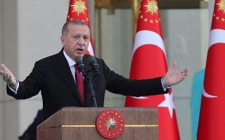 Turkish President Tayyip Erdogan, accompanied by his wife Emine Erdogan, makes a speech during a ceremony at the Presidential Palace in Ankara, Turkey July 9, 2018. REUTERS/Umit Bekta