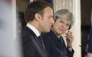 Britain's Prime Minister Theresa May and French President Emmanuel Macron during a media conference at the Royal Military Academy Sandhurst, in Camberley, England, after UK-France summit talks, Thursday Jan. 18, 2018.  The leaders announced that police and security services from France and England will open dialogue links to help combat extremism and terrorist threats. (Stefan Rousseau/Pool via AP)