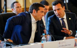 epa06878307 Greece's Prime Minister Alexis Tsipras (L) speaks with former Yugoslav Republic of Macedonia (FYROM)'s Prime Minister Zoran Zaev at the Western Balkans Summit 2018 in London, Britain, 10 July 2018. Speaking in Brussels in 2017, British Prime Minister Theresa May said the international community must make a more visible commitment to security in the western Balkans in light of the Russian threat as she promised to increase British support for the region.  EPA/LUKE MACGREGOR / POOL