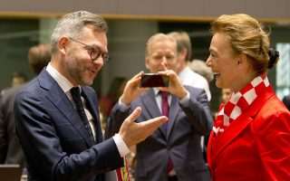 CAPTION CORRECTS ID OF GERMAN FOREIGN MINISTER TO MINISTER OF STATE FOR EUROPE German Minister of State for Europe Michael Roth, center, speaks with Croatian Foreign Minister Marija Pejcinovic Buric during a meeting of EU foreign ministers at the Europa building in Brussels, Monday, July 16, 2018. (AP Photo/Virginia Mayo)
