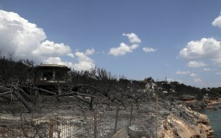 A burned compound is seen next to the sea in Mati, east of Athens, Wednesday, July 25, 2018. Rescue crews were searching Wednesday through charred homes and cars for those still missing after the deadliest wildfires to hit Greece in decades decimated seaside areas near Athens, killing at least 79 people and sending thousands fleeing. (AP Photo/Thanassis Stavrakis)