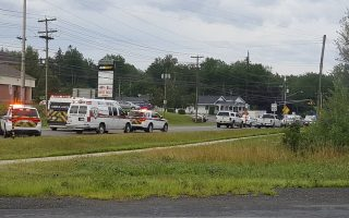 Emergency vehicles are seen at the Brookside Drive area in Fredericton, Canada August 10, 2018 in this picture obtained from social media. Kev Bourque/via REUTERS THIS IMAGE HAS BEEN SUPPLIED BY A THIRD PARTY. MANDATORY CREDIT. NO RESALES. NO ARCHIVES.