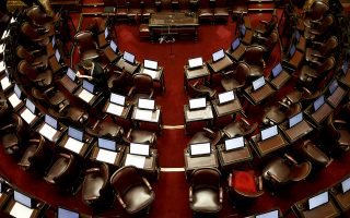 Argentina's Senates seats are seen empty ahead of a debate on a legislation that would decriminalize abortions in Buenos Aires, Argentina Wednesday, Aug. 8, 2018. Following months of increasingly tense debate, lawmakers in Argentina meet in Congress on Wednesday ahead of a vote on a bill that would decriminalize abortions up to the first 14 weeks of pregnancy.(AP Photo/Natacha Pisarenko)