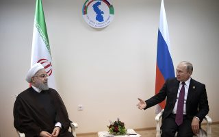 epa06945761 Russian President Vladimir Putin (R) meets with Iranian President Hassan Rouhani (L) during the 5th Caspian summit at the Friendship Palace in Aktau, the Caspian Sea port in Kazakhstan, 12 August 2018. The leaders of five countries bordering the Caspian Sea - Caspian Five - Russia, Iran, Kazakhstan, Azerbaijan, and Turkmenistan sign the Convention of the legal status of the Caspian Sea at the Aktau summit on 12 August.  EPA/ALEXEY NIKOLSKY/SPUTNIK/KREMLIN / POOL MANDATORY CREDIT