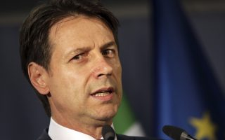Italian Prime Minister Giuseppe Conte speaks during a media conference at an EU summit in Brussels, Friday, June 29, 2018. European Union leaders cried victory Friday, claiming to have set aside major differences over how best to handle migrant arrivals. (AP Photo/Olivier Matthys)