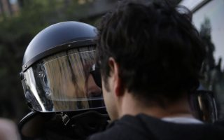 A demonstrator argues with a police officer during a May Day demonstration in Berlin, Germany, Tuesday, May 1, 2018. (AP Photo/Markus Schreiber)