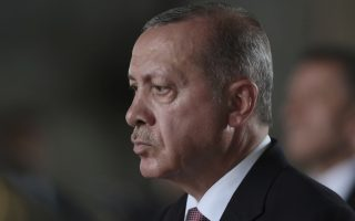 Turkey's President Recep Tayyip Erdogan stands during a ceremony at the mausoleum of Mustafa Kemal Ataturk, founder of modern Turkey, in Ankara, Turkey, Thursday, Aug. 2, 2018. The United States on Wednesday slapped sanctions on Turkish Justice Minister Abdulhamit Gul and Interior Minister Suleyman Soylu, seemingly aimed at pressuring its NATO ally into releasing a detained American pastor who is being tried on espionage and terror-related charges.(AP Photo/Burhan Ozbilici)