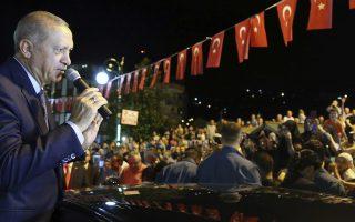 Turkey's President Recep Tayyip Erdogan addresses supporters at his Black Sea hometown, Guneysu, Turkey, early Friday, Aug. 10, 2018. Turkey's Finance and Treasury Minister Berat Albayrak will reveal a
