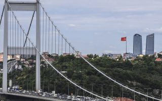 A day after elections, traffic crosses the Fatih Sultan Mehmet Bridge over the Bosporus Strait, separating Asia and Europe in Istanbul, Monday, June 25, 2018. Turkey's President Recep Tayyip Erdogan, 64, who has dominated Turkish politics for the past 15 years, is the winner of Sunday's polls and was set to extend his rule with sweeping new powers after winning landmark presidential and parliamentary elections. (AP Photo/Emrah Gurel)