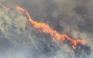 In this Wednesday, Aug. 1, 2018 image taken from video provided by Fox-12 Oregon, a wildfire rages near Dufur, Ore. The fire forced mandatory evacuations in the north central Oregon community. (Fox-12 Oregon via AP)