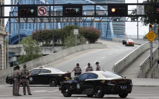 Florida Highway patrolmen block the entrance to the Main Street Bridge near the scene of a mass shooting at Jacksonville Landing in Jacksonville, Fla., Sunday, Aug. 26, 2018. Florida authorities are reporting multiple fatalities at the riverfront mall that was hosting a video game tournament. (AP Photo/John Raoux)