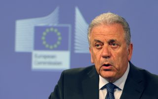 EU Commissioner for Migration, Home Affairs and Citizenship Dimitris Avramopoulos address the media at EU Commission headquarters in Brussels, Belgium, Wednesday, July 13, 2016. The European Union's executive arm is proposing new EU-wide rules for granting asylum and resettlement for migrants, among the most controversial of political issues in many European countries. The proposals were made public Wednesday by EU officials. (AP Photo/Darko Vojinovic)