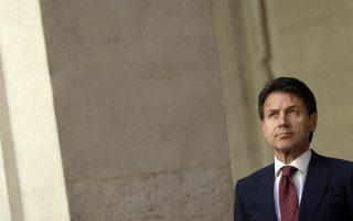 Italian Premier Giuseppe Conte waits for the arrival of NATO Secretary General Jens Stoltenberg at Chigi Palace, in Rome, Monday, June 11, 2018. (AP Photo/Gregorio Borgia)